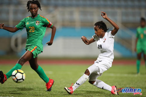 Photo: Trinidad and Tobago forward Aaliyah prince (right) tries to squeeze a shot past Grenada defender Judy McIntosh during CFU Challenge Series action at the Ato Boldon Stadium, Couva on 27 April 2018. Prince scored three times in a 8-1 win for T&T. (Copyright Allan V Crane/CA-Images/Wired868)