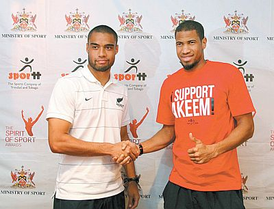 New Zealand skipper and West Ham United defender, Winston Reid, left, shakes hands with T&T defender Radanfah Abu Bakr during a pre-match media conference, held at Trotters Bar and Grill, Maraval Road, yesterday. The two teams will clash in an international friendly at the Hasely Crawford Stadium, Mucurapo, from 7.15 pm this evening. Photo: Brian Ng Fatt.