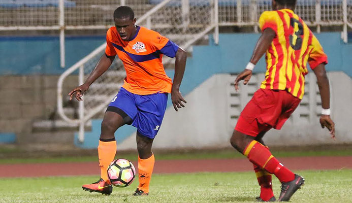 ​Photo: Club Sando forward Akeem Roach, left, during his team's Digicel Pro League clash with Point Fortin Civic at the Ato Boldon Stadium on Jan. 27, 2017.