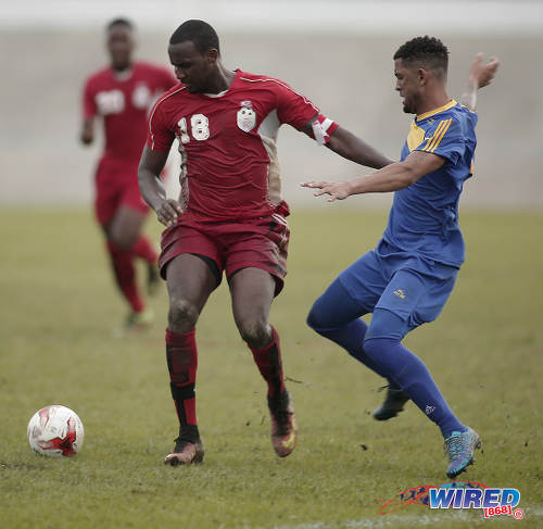 Photo: Bethel United defender Makan Hislop (left) shrugs off a challenge from FC Santa Rosa attacker Rashad Griffith during TTSL One action at the Arima Velodrome on 18 June 2017.  Santa Rosa won 2-0. ... (Courtesy Annalicia Caruth/Wired868)