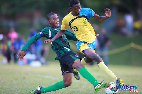 Photo: Carapichaima East Secondary's Cadiz Chandler (left) tackles Speyside High School's Shaffie McKenzie during 2015 SSFL Premier Division action in Speyside, Tobago. ..(Courtesy Allan V Crane/Wired868)