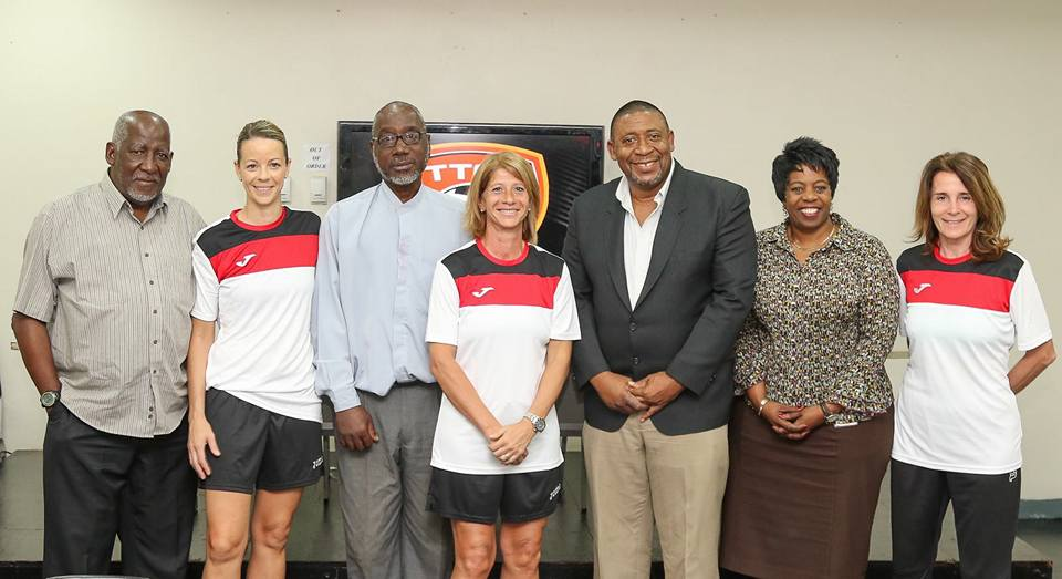Carolina Morace (centre) stands next to TTFA President David John-Williams, Vice President Ewing Davis (third from left), Vice President Joanne Salazar (second from right), Assistant Coach Elisabetta Bavagnoli (far right), TTFA Technical Director Muhammad Isa (far left) and Assistant coach Nicola Williams (second from left) following Wednesday's Press Conference at the Ato Boldon Stadium Press Conference Room. Photo by Sean Morrison.