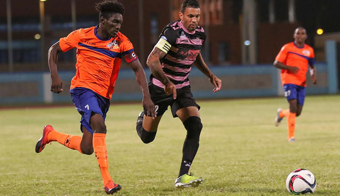 Captains' chase: Club Sando's Akeem Humphrey, left, and Ma Pau Stars' Carlos Edwards vie for the ball duri quarter-final round of the Digicel Pro Bowl at the Ato Boldon Stadium on Feb. 9, 2017.