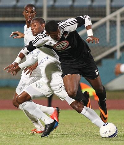 Central FC's Dwight Quintero, right, and W Connection's Mikheil Williams battle for the ball during one of their meetings during last year's Digicel T&T Pro League at the Ato Boldon Stadium, Couva. Photo: Anthony Harris