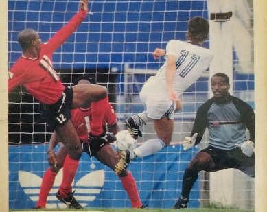 "Photo: Trinidad and Tobago goalkeeper Earl ""Spiderman"" Carter (right) braces for a United States effort while teammates Paul Elliot-Allen (left) and Brian Williams look on during the 1990 World Cup qualifying series."