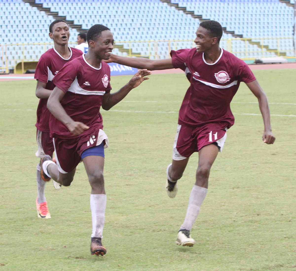 Kevon Edwards of East Mucurapo, centre, celebrates his goal with teammates yesterday in an Intercol match against Diego Martin North yesterday at the Hasely Crawford Stadium, Mucurapo.