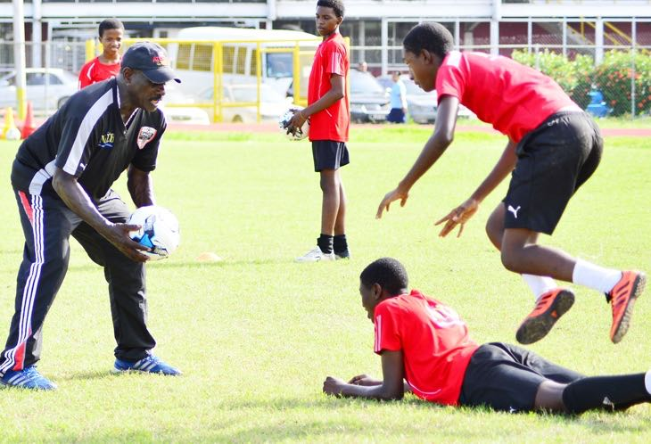 Everald 'Gally' Cummings going through the paces with the future footballers of Trinidad and Tobago. Photos Stephen Doobay