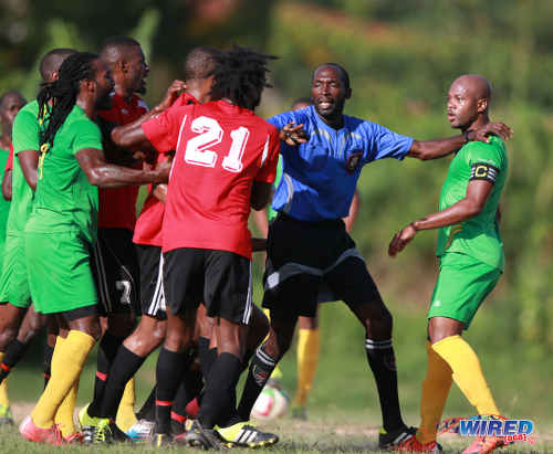 Photo: Referee Hasely Collette (centre) plays peacemaker while then Guaya United captain Ryan Stewart (right) assesses the situation during 2015/16 CNG NSL Premiership Division action at Matura. ...(Courtesy Nicholas Bhajan/Wired868)