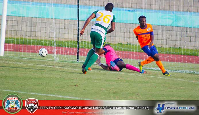 Guaya United forward Kevin Jagdeosingh (#26) watches the ball past Club Sando goalkeeper Kelvin Henry during their FA Trophy 2017 Round-of-32 clash at the Mannie Ramjohn Stadium on Oct. 5, 2017. Guaya won the game 6-5 on penalties after a 1-1 draw. (Photo courtesy Guaya United / Hydro Tech Ltd)