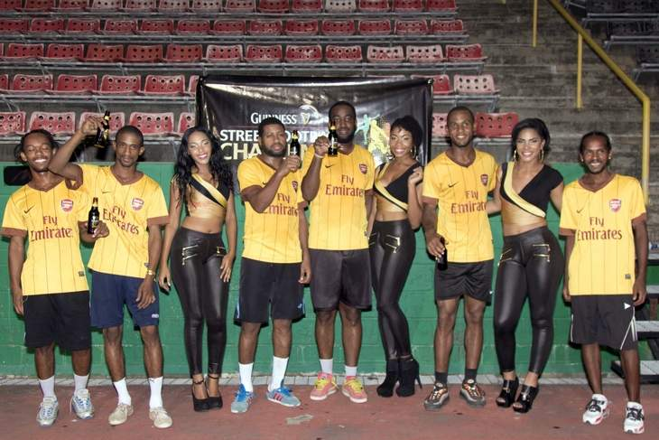 NORTH ZONE CHAMPS: Guinness Street Football Challenge 2015 north zone winners, Basic pose with representatives of the Guinness promotional team following their victory at the Jean Pierre Complex, Port of Spain, on Saturday.