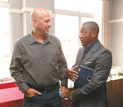 Former Soca Warriors midfielder Russell Latapy, right, and Soca Warriors head coach Stephen Hart. PHOTO: ABRAHAM DIAZ