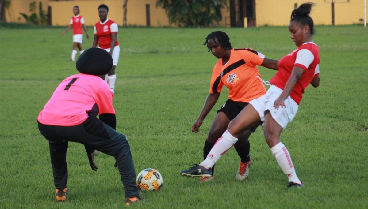 National footballer Jonelle Cato, right, in action for Trincity Nationals vs Club Sando last year.