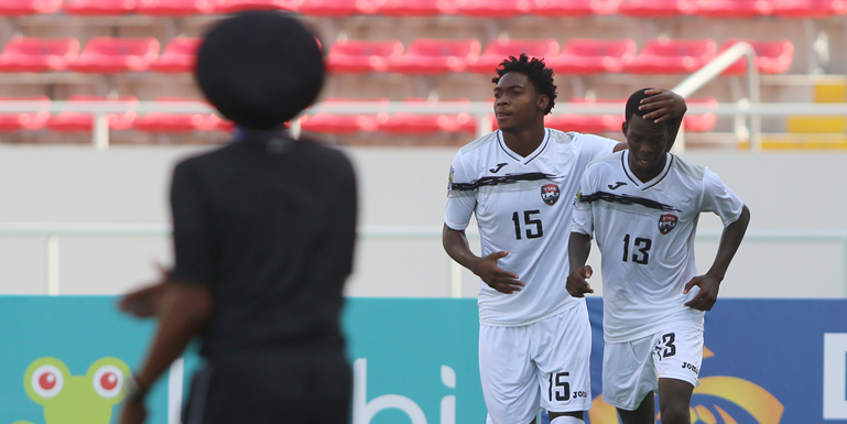 Trinidad & Tobago's Kathon St. Hilaire (#15) celebrates with teammate Micah Lansiquot after scoring against El Salvador in the CONCACAF Under-20 Championship on February 25, 2017, in Tibas, San Jose, Costa Rica. (Photo: Straffon Images)