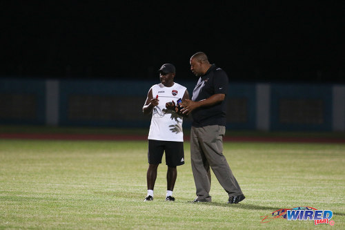 Photo: TTFA president David John-Williams (right) has a word with Trinidad and Tobago National Under-17 Team coach Russell Latapy on the training ground before the CFU competition. (Courtesy Chevaughn Christopher/Wired868)