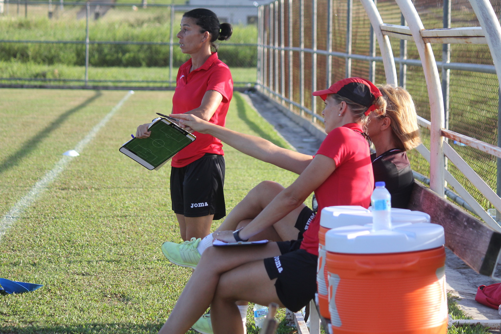 Nicola Williams points out an observation to Carolina Morace and Manuela Tesse during U-17 trials on Saturday.