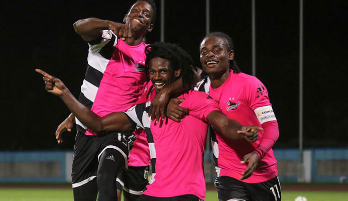 ​​Photo: Central FC's Jason Marcano, centre, in celebration with teammates Kaydion Gabriel and Darren Mitchell.
