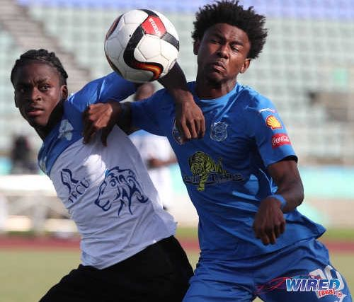 Photo: Naparima College forward Seon Shippley (right) and Presentation College defender Justin Cornwall tussle for the ball during the South Zone Intercol final at the Mannie Ramjohn Stadium on 26 November 2018. ...(Copyright Kerlon Orr/CA-Images/Wired868)