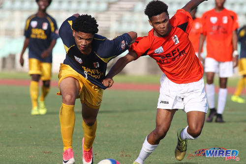 Photo: North All-Star winger Kishon Hackshaw (left) tussles with South All-Star left back Matthew Beal during the SSFL Field of Dreams All-Star contest at the Mannie Ramjohn Stadium on 10 December 2017. (Courtesy Chevaughn Christopher/Wired868)