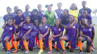 Pleasantville Secondary School girls' football team pose after beating Penal Secondary 3-0 at the InterCol South Zone Final at the Manny Ramjohn Stadium, Marabella.