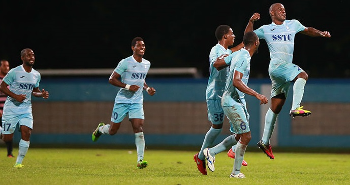 Photo: Police FC players including Kareem Freitas, second from left, and Elijah Belgrave, airborne, celebrate a goal during the 2016-17 Pro League season.