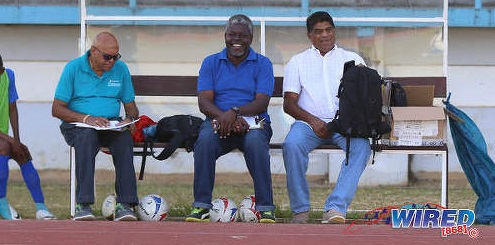 Photo: All Sports Promotion director Anthony Harford (right) and administrators Camal Basdeo (left) and Gerald Elliot enjoy RBNYL action at the Larry Gomes Stadium on 18 March, 2018. ...(Copyright Sean Morrison/Wired868)