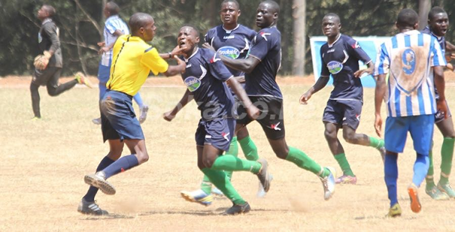 Referee being beaten up by St. Mary's Kitende players after losing to Alliance