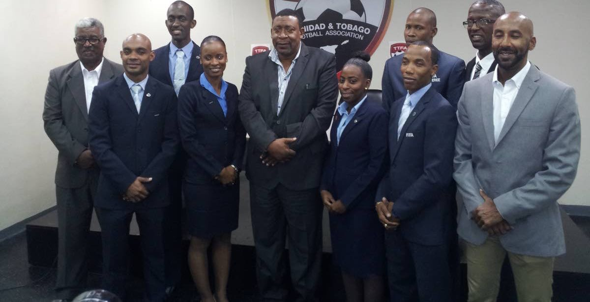 President of the TT Football Association David John-Williams, fifth from left, along with local referees and local referee administrators at the Ato Boldon Stadium in Couva, yesterday. Seven local referees received FIFA badges yesterday.