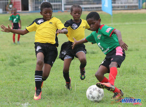 Photo: San Juan Jabloteh's Raheem Mohan (right) tries to elude two Cunupia Extreme players during RBNYL Under-11 action at Constantine Park in Macoya on 10 June 2017. Jabloteh won 2-0. ...(Courtesy Sean Morrison/Wired868)