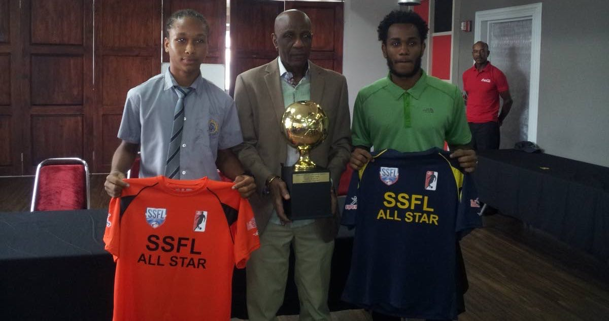 Former national player Steve David, centre, poses with the All-Star Game trophy alongside South captain Judah Garcia, left, and North skipper Matthaeus Granger at the VIP Lounge, Hasely Crawford Stadium, Mucurapo, yesterday.