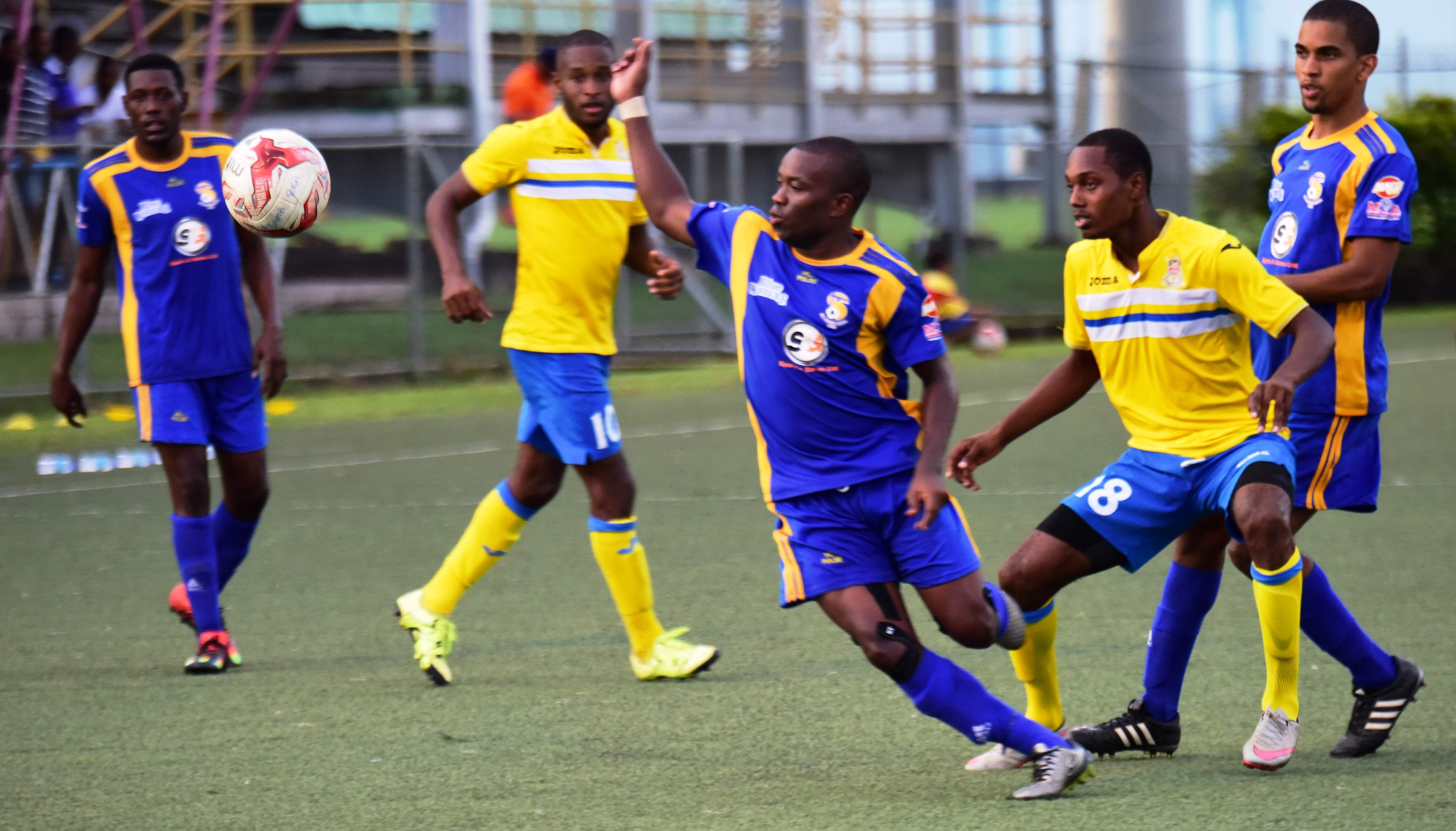 National Super League action between 2016 Champions FC Santa Rosa (purple) and Defence Force earlier this season. The teams filled the top two spot in the competition.