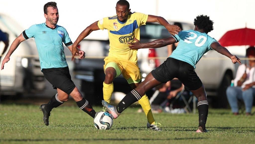 Santa Rosa's Kheelon Mitchell (centre) tries to get past Queen's Park defenders Shomari Antoine (#20) and Jason Devenish (left) during the TTSL Match day #18 between QP and Santa Rosa at St Mary's College Grounds, St. Clair, on Sunday. The match ended 1-1.