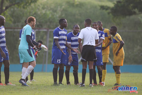 Photo: WASA FC captain Cleveland Cambridge (third from left) and Kevon Henry (centre) lead the complaints to referee CJ O' Brien after he awarded a penalty to FC Santa Rosa during TTSL One action in St Joseph on 9 July 2017. ...(Courtesy Chevaughn Christopher/Wired868)
