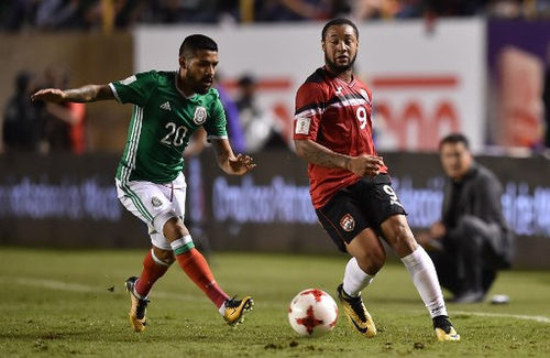 Photo: Trinidad and Tobago forward Shahdon Winchester (right) tries to keep the ball from Mexico winger Javier Aquino during World Cup qualifying action in San Luis Potosi, Mexico on 6 October 2017. ...(Copyright AFP 2017/Yuri Cortez)