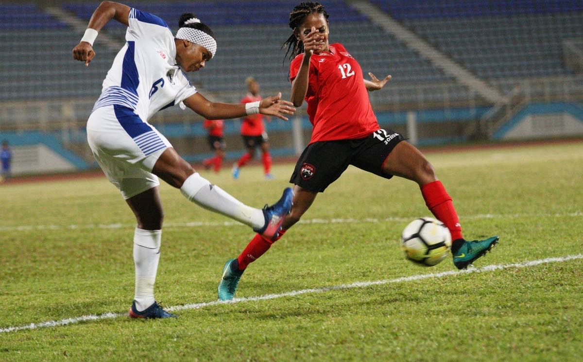 T&T's Shanelle Arjoon,right, defends a shot from Kenia Rangel, of Panama, on Thursday during a international friendly held at the Ato Boldon Stadium, Couva.