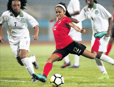 T&T's Summer Shenelle Arjoon attempts a shot at goal during the CFU Women's Challenge Series 2018 between T&T and Suriname at the Ato Boldon Stadium, Couva on Wednesday. T&T won 7-0. PICTURE MATTHEW LEE KONG