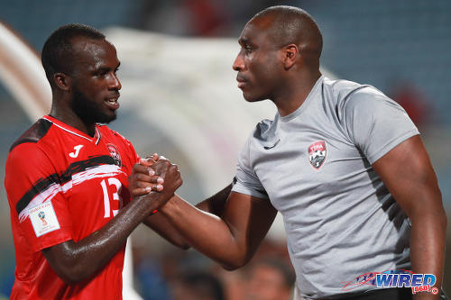 Photo: Trinidad and Tobago assistant coach Sol Campbell (right) congratulates striker Jamille Boatswain after his double strike against Barbados in a 2-0 win at the Ato Boldon Stadium on 10 March 2017. (Courtesy CA Images/Wired868)