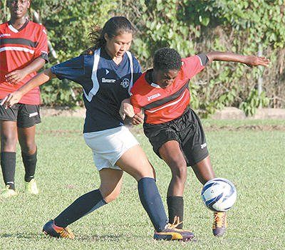Kimberlee Woo Ling, right, of St Joseph Convent (PoS) challenges Arissa Romany of Bishop's Anstey (PoS) in their North Zone BGTT/First Citizens Secondary Schools Football League Girls Championship Division match at St Joseph Convent Ground, Federation Park, St Clair, on Sunday. Bishop's Anstey won 1-0. Photo: Anthony Harris