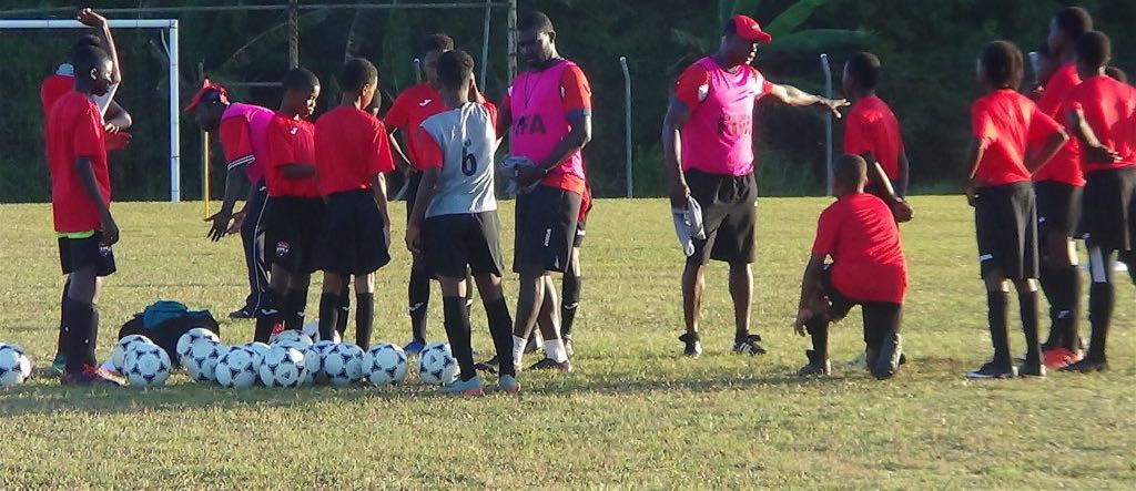 Stuart Charles-Fevrier talks to a few of his players at training on Thursday at the TTFA Home of Football in Couva/TTFA Media.