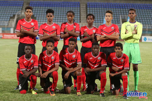 Photo: The Trinidad and Tobago National Under-15 Team players pose before kick off against a Republic Bank XI at the Ato Boldon Stadium on 15 April 2017. (Courtesy Sean Morrison/Wired868)