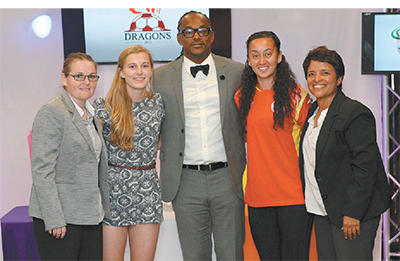 Minister of Sport Brent Sancho, centre, is flanked by Women's Premier League coaches, Joanne Daniel, far left, and Carla Aleman, far right, both of whom lead the franchise, Dragons, along with the team's drafted players, Isabella Hayes of the UK, left, and T&T woman player of the year, Arin King, right, at the draft for the Women's Premier League, at the Hasely Crawford Stadium, Mucurapo, yesterday. Photo: Anthony Harris.
