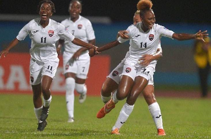 CELEBRATION TIME: Trinidad and Tobago U-20 women celebrate Kedie Johnson's (#14 ) goal from a corner-kick which provided T&T with a two-goal cushion against Haiti on Thursday night at Ato Boldon Stadium, Couva. Teammates Renae Ward, left, Dennecia Prince, second left, and Shenieka Paul (partially hidden) join in the celebrations. However, Haiti rallied for a come-from-behind 3-2 victory in the U-20 Women CONCACAF Championship contest. --Photo: DEXTER PHILIP