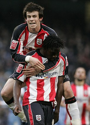 Killer touch: Jones celebrates after scoring against Sheffield Wednesday for Southampton (right) and with rising star Gareth Bale (left) while at St Mary's