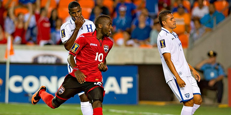 Trinidad & Tobago clinched a place in the CONCACAF Gold Cup quarterfinals, defeating 10-man Honduras 2-0 on Monday at BBVA Compass Stadium. Kenwyne Jones and Kevin Molino scored second-half goals in the triumph.