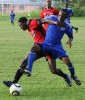 Defence Force's Richard Roy, right, wins the battle for the ball ahead of St Ann's Rangers' Kareem Moses in their Digicel T&T Pro League match at the Larry Gomes Stadium, Malabar, on Tuesday night. Roy scored a hat-trick in his team's 3-1 win.