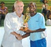 Defender Rhea Belgrave, right, receives the Player of the Final trophy from Director of National Women's Football and sponsor of the tournament, Even Pellerud, at the closing ceremony of the Women's League Football (Wolf) Big-Four.