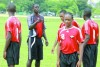 T&T Under-17 footballers interim coach Ross Russell has the attention of some of his players during a training session at the Queen's Park Savannah, St Clair, yesterday in preparation for today's match against St Kitts/Nevisin Group E of the Caribbean Football Union Second Round qualifiers at the Marvin Lee Stadium, Macoya from 11am. Photo: Anthony Harris