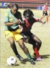 Jamaica's Shantell Thompson (left) battling with Trinidad and Tobago's Khadisha Debesette during yesterday's final match in the Under-17 Women's Caribbean Football Union World Cup qualifiers at the Anthony Spaulding Sports Complex in St Andrew. (Photo Credit: Jamaica Gleaner).