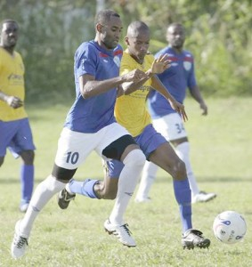 St Francois captain Marlon Bowen (right) gets past Immanuel Alexander of WASA during their bmobile National Super League encounter at the WASA ground St Joseph, yesterday. WASA won the match 1-0. Photo Anthony Harris.