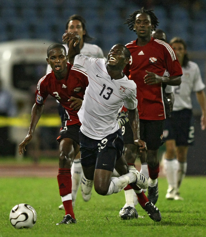US football player midfielder Maurice Edu (Center) is tackled by Trinidad and Tobago' s defender Aklie Edwards (L) and midfielder Keon Daniel during their FIFA World Cup South Africa-2010 qualifier football match at the Hasely Crawford stadium in Port of Spain, on October 15, 2008. AFP PHOTO / THOMAS COEX (Photo credit should read THOMAS COEX/AFP/Getty Images)