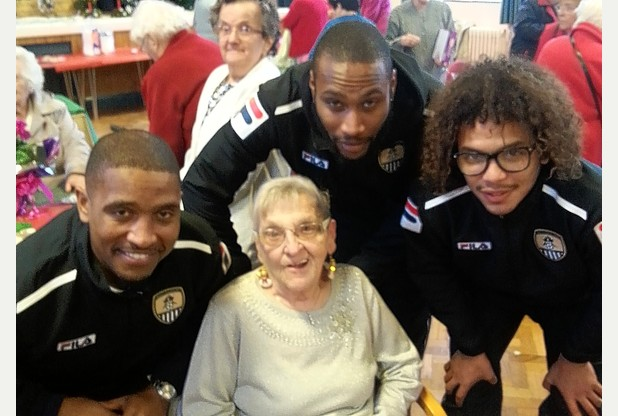 Notts County players Andre Boucaud, Yohann Arquin and Jeremy Balmy with Brenda Read, 84, a lifelong fan of the club, who has been going to Meadow Lane for 79 years.  Read more: http://www.nottinghampost.com/Christmas-comes-early-lifelong-Notts-County-fans/story-20306152-detail/story.html#ixzz2nAb8B9dr